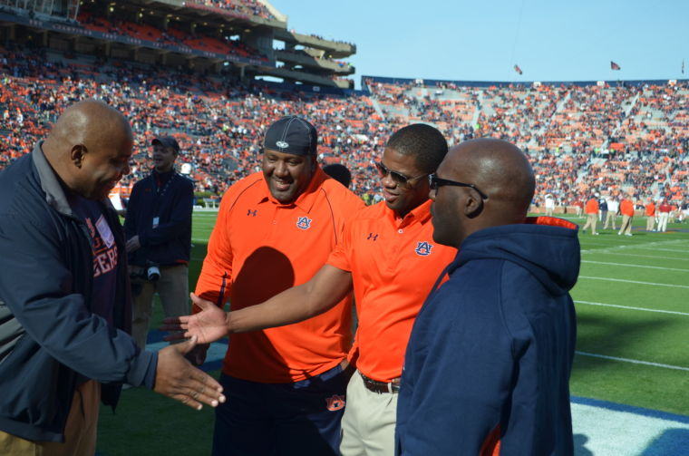 Coach Dameyune V. Craig greets former AU players on the field before the Iron Bowl