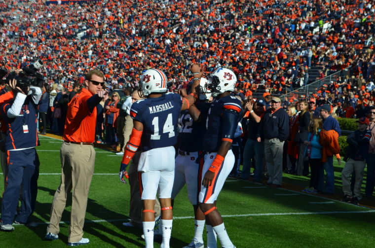 Nick Marshall (No. 14) taking direction from Coach Lashlee