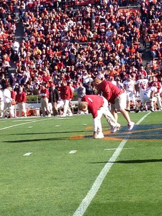 Nick Saban stealing grass off Pat Dye Field