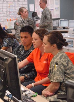 AU student working with veterans at Walter Reed