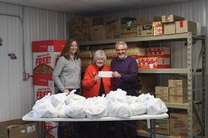 Toycen Motors & Bloomer Ford Donate To Bloomer Food Pantry