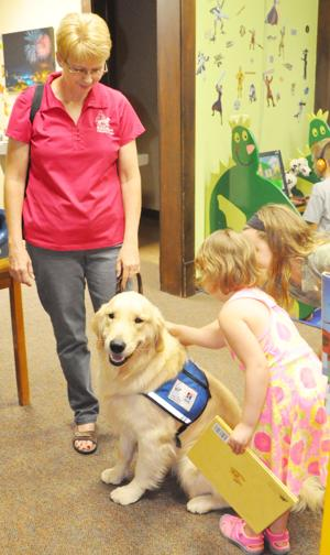 Facility dogs trained to calm people, kids