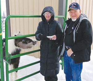 High Rocky Riders present donation checks