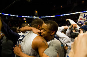 Frazier (23) and Newbill (2) embrace after win