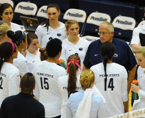 <p>Head Women's Volleyball Coach Russ Rose speaks to the team during the Oct. 8, 2014 match against Northwestern</p>