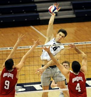 <p>Matt Seifert (18) spikes the ball over Ohio State's Nicolas Szerszen (9) and Driss Guessous (4) in Rec Hall on Saturday, Mar. 21st, 2015. Penn State won the game 3-2.</p>