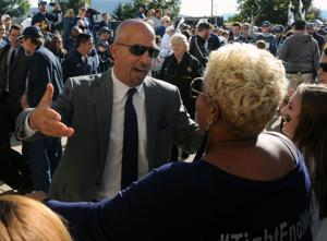 Head coach James Franklin reaches to hug