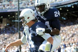 Nick Scott (24) leaps onto Christian Hackenberg (14)