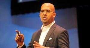 <p>James Franklin speaks at Schwab Auditorium during the 2015 TEDxPSU event.</p>