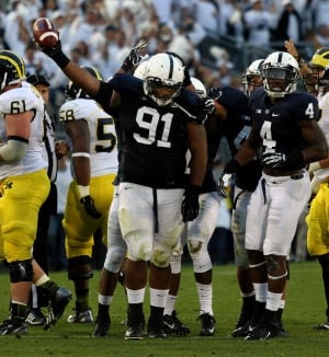 DaQuan Jones (91) Celebrates fumble