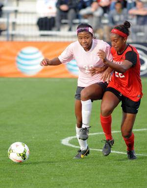 <p>Penn State's Salina Williford (20) carries the ball past Rutger's Brianne Reed (22) during Saturday afternoon's match up at Jeffrey Field.</p>