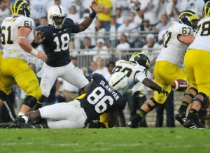 <p>CJ Olaniyan (86) sacks Michigan's Quarterback Devin Gardner (98), causing a fumble picked up by Penn State in 2013. Penn State won the game, 43-40, after four overtimes.</p>