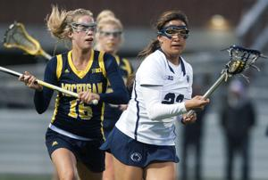 <p>Steph Lazo (23) carries the ball during the game against Michigan on Thursday, April 9, 2015 at the Penn State Lacrosse Field. The Nittany Lions defeated the Wolverines 11-5.</p>