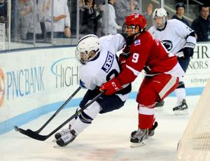 Nate Jensen (24) tries to clear puck