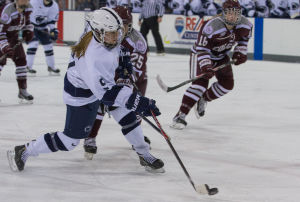 <p>Amy Petersen (9) shoots the puck while avoiding a stick check from Hannah Rastrick (25) during a game against Colgate at Pegula Ice Arena on Friday January 10, 2014. Penn State lost to Colgate 3-2 in overtime.</p>