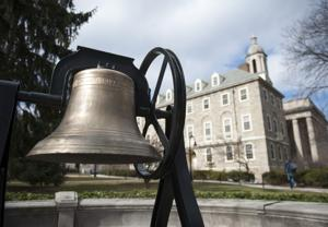 <p>The Old Main bell, the 2009 student class gift, next to Old Main on Wednesday, April 1, 2015.</p>