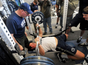 Galt spots Hackenberg during max bench press