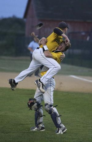 <p>Catcher Nolan Weber hoists Derek Lieurance in celebration of the Cougars' sub-state victory.</p>