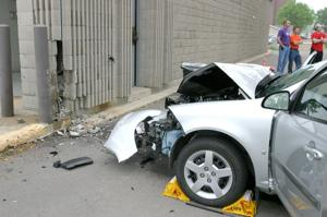 Woman hurt when car crashes into fire hall
