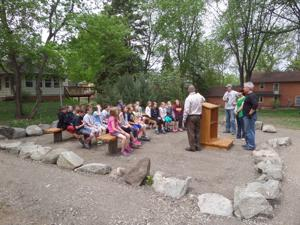 Adult students lead to the way to outdoor classroom