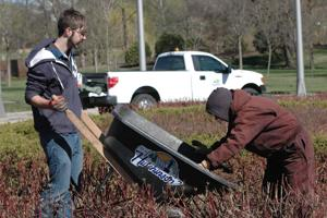 Volunteers get in the dirt for Earth Day