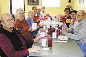 Cards lift spirits of 60s-Plus diners