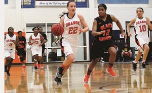 "<p style=""text-align: left;"" align=""right"">Laine Harrington leads the fast break with Kiani Hudgens (left) and Deja Wilson (right) in Friday's thrilling 40-36 win over Charlottesville in Orange. The Hornets handed the Black Knights their first Jefferson District loss of the season and rebounded from a loss to Western Albemarle a night earlier. Harrington had 11 rebounds and nine points in the win.</p>"