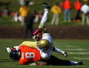 <p>Virginia safety Anthony Harris (8) tackles Georgia Tech running back Synjyn Days (10) in the first half on Saturday at Scott Stadium in Charlottesville, Va. Photo / Ryan M. Kelly / The Daily Progress</p>