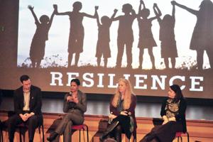 <p>Jamie Clancey talks about dealing with trauma while participating in a panel discussion at the State Theatre Wednesday evening.</p>