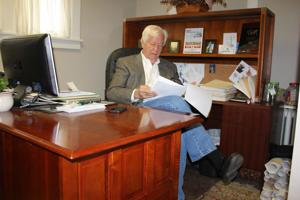 <p>Local commercial REALTOR Tom Boyd reviews paperwork inside his RE/MAX Crossroads office located on South Main Street. Boyd received the Culpeper Chamber of Commerce Chairman's Award during a ceremony held at Germanna Community College's Daniel Technology Center on Nov. 5.</p>