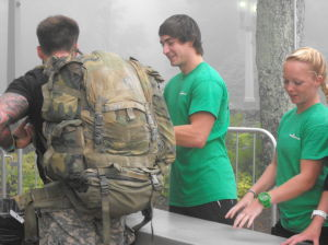 <p>Kyle Vrhovac and Pierce Byrd help a participant with his bags to be checked at the 2014 Virginia Super Spartan held Saturday at Wintergreen Resort in Roseland.</p>