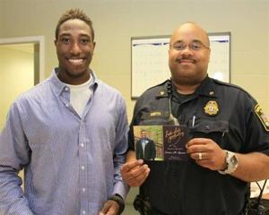 <p><span>Lantae Spencer (left) surprised Officer Fred Smith with an invitation to his high school graduation. When Spencer was an infant, Smith resuscitated him after he stopped breathing.</span></p>