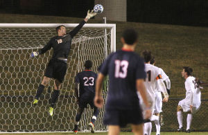 <p>Virginia goalkeeper Calle Brown (18) tips a shot away from the goal during the second half of an NCAA soccer match against Connecticut on Friday in Charlottesville, Va. Photo / Ryan M. Kelly / The Daily Progress</p>