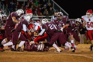 <p>Riverheads' Cole Smiley (34) is surrounded and be brought down by Cougars Brandon Terrell (5), Colton Stiltner (18) and Jonathon White (24)</p>