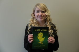 <p>Rachel Lynn Heimburger, 18, has a passion for art and used her talent to illustrate a children's book of jokes. </p>
