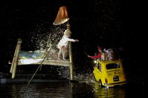"<p>Artists perform their ""Fous de Bassin"" show, created by French company Ilotopie, on the water canals around the Puerto Madero neighborhood at the opening of IX Buenos Aires' International Festival in Buenos Aires, Argentina, Friday, Oct. 4, 2013. </p>"