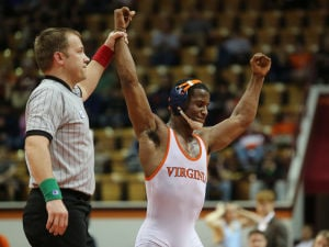 <p>UVa sophomore Blaise Butler celebrates winning the 157-pound weight division at the ACC Championships held in Blacksburg. Photo: Jim Daves/Virginia media relations</p>