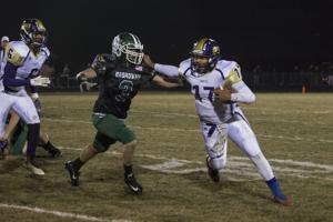 <p>Quarterback Chris Baker (17) stiff-arms Broadway's C.K. Ray (3) during the Waynesboro vs Broadway game on Friday evening</p>
