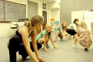<p>Ashley Showalter, left, Addison Hammond, Julia Dixon, Justine Juart and Cam Strickland practice the spider walking during a rehearsal at the nTelos Theatre in Staunton.</p>