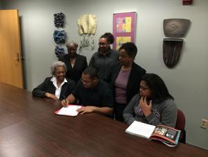 <p><span>Waynesboro High lineman Shawn Hubbard, surrounded by family, signed with Averett University on Friday.</span></p>