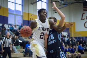 <p>Dribbling past a Page County player, Little Giant DeVante Robinson (24) goes for a basket during the game Saturday against Page.</p>