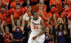 <p>Virginia forward Akil Mitchell (25) celebrates an early basket as he runs back up the court during the first half of an NCAA college basketball game against Liberty on Saturday in Charlottesville, Va. Photo / Ryan M. Kelly / The Daily Progress</p>