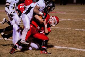 <p>Riverheads, Benjamin Agnor (8) is taken down by King William's Camajae Peatross during their game Friday night at Riverheads High School.</p>