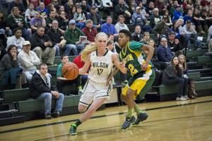 <p>Wilson's Morgan Rowe, 12, dribbles towards the basket during the game Tuesday against Bruton.</p>