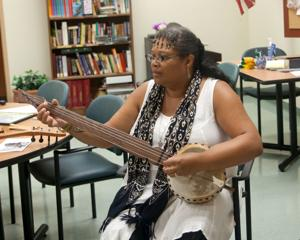 "<p style=""text-align: right;"">TERRY BEIGIE/GREENE COUNTY RECORD</p><p>Dr. Dena Jennings plays one of her gourd banjos at the monthly Greene County TRIAD meeting last week.</p>"