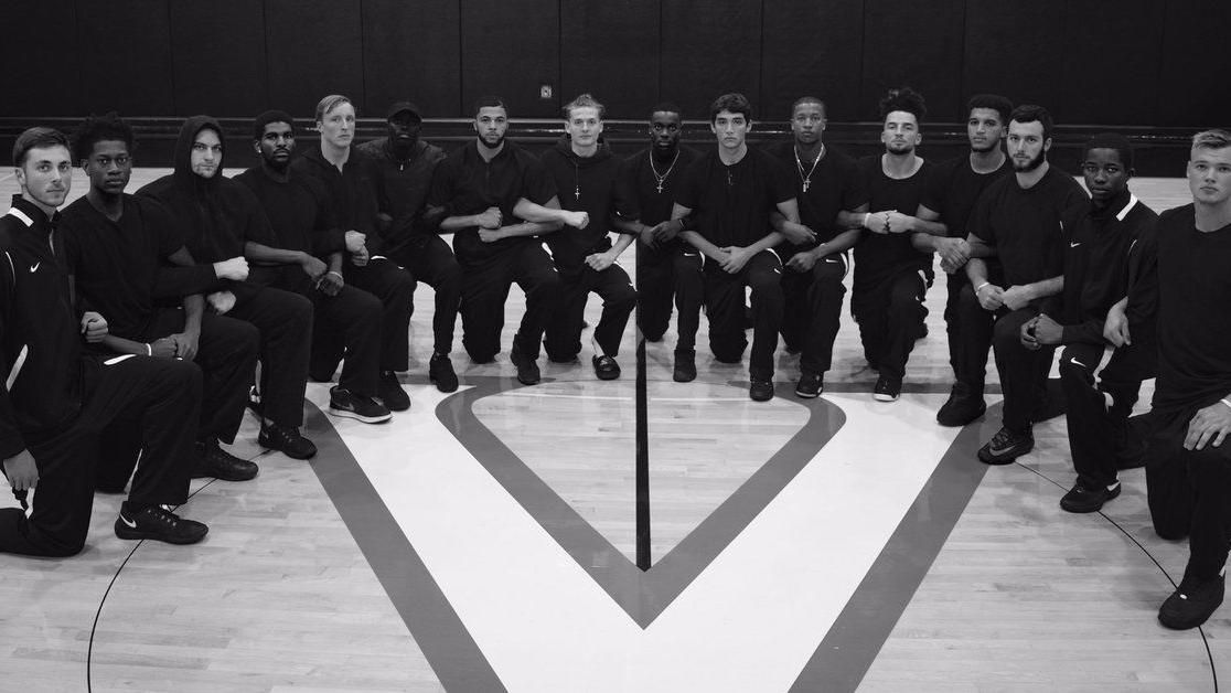 Virginia men's basketball team kneels for 'injustice' and 'equality' in photo