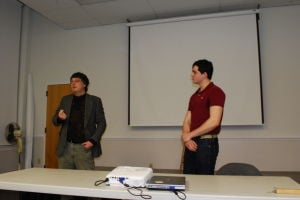 <p>Dr. Jon Crawley (left) and his student Joseph Lombard speak to the group Tuesday night, explaining how cities can survive through the centuries</p>