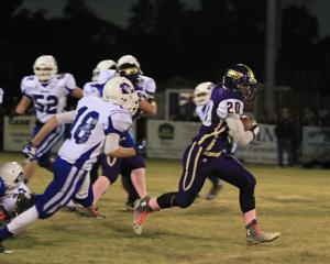 <p>Waynesboro's Dominique Gray rushes past the Fort Defiance defense in his team's blowout win on Friday night.</p>