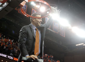 <p>Virginia head coach Tony Bennett holds up the net he cut down after the end of an NCAA basketball game against Syracuse on Saturday in Charlottesville, Va. Photo / Ryan M. Kelly / The Daily Progress</p>