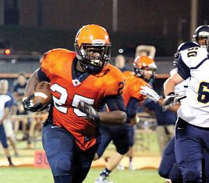 <p>Running back Trevon Smith, above, carried 15 times for 107 yards and two scores in Friday night's game. </p>